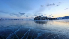 4K. Sunset on the frozen Lake Baikal, Oltrek island. Irkutsk region, Russia.  Stock Footage