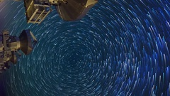 Astro Timelapse of Star Trails over Array of Radio Observatories -Vertical/Pan- Stock Footage
