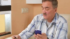 Senior man with a mustache makes a purchase from the online store credit card Stock Footage