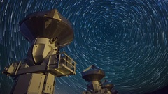 Astro Timelapse of Star Trails over Array of Radio Observatories -Zoom In- Stock Footage