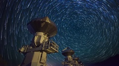 Astro Timelapse of Star Trails over Array of Radio Observatories -Pan Left- Stock Footage