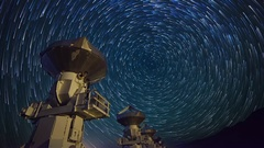 Astro Timelapse of Star Trails over Array of Radio Observatories -Pan Right- Stock Footage