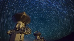 Astro Timelapse of Star Trails over Array of Radio Observatories -Tilt Down- Stock Footage
