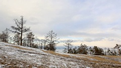 4K. Movement of clouds above the forest on Olkhon Island, Lake Baikal, Irkuts Stock Footage