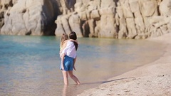 Family during on beach on greek vacation. Mother and kid enjoy summer by the sea Stock Footage