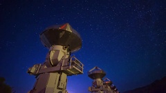 Astro Timelapse of Starry Sky over Array of Radio Observatories -Pan Right- Stock Footage