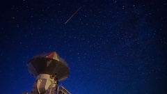 Astro Timelapse of Starry Sky over Array of Radio Observatories -Tilt Down- Stock Footage