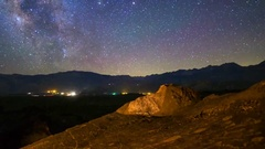 MoCo Tracking Astro Timelapse of Milky Way over Indian Petroglyphs -Zoom Out- Stock Footage