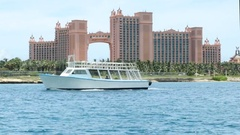 Atlantis resort with boat passing by Stock Footage