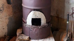 Zoom Out Barrel Stove at Riley's Cabin Camp - Mojave Desert California Stock Footage