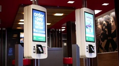 Motion of ordering food machine at Mcdonalds with 4k resolution Stock Footage