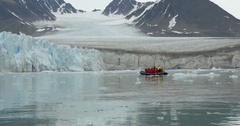 Expedition sailing near iceberg on Rubber boat in the North Pole Stock Footage