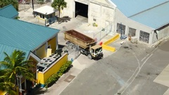 Overhead shot of garbage truck on ship pier / dock Stock Footage