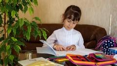 Schoolgirl doing homework Stock Footage