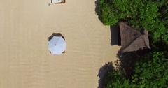 Nusa Dua beach. Deckchairs, umbrellas. Aerial view. Bali indonesia Stock Footage