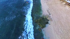 Surfers in ocean. Balangan beach. View of cliffs. Aerial view. Bali Indonesia Stock Footage