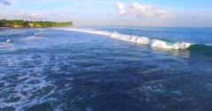 Ocean waves closeup and view of the stone cliffs. Aerial view. Balangan Stock Footage