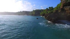 View of the stone cliffs from the ocean side. Aerial view. Balangan beach. Stock Footage