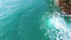 Ocean waves closeup and view of the stone cliffs. Aerial view. Balangan beach. Stock Footage