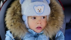 Rides child in the car on the child car seat closeup Stock Footage