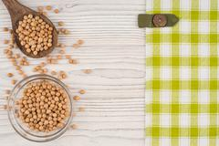 Chickpeas on old wooden table. Stock Photos