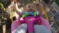 Little Girl Swinging in Slow motion Stock Footage
