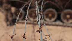 Barbed wire. Tank in the desert. Stock Footage