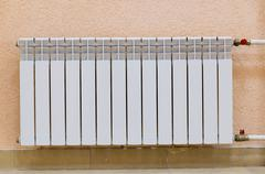 White new radiator on pink wall Stock Photos