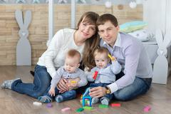 Happy young family are built of wooden planks house Stock Photos