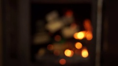 The process of focusing on the wood and branches in the fireplace erupted. Stock Footage