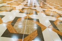 Floor tiled with patterns like parquet Stock Photos