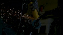 Close up on angle grinder shooting sparks. Slow motion. Stock Footage