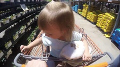 Little Girl Riding in a grocery cart Arkistovideo