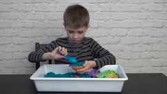 Little boy sculpting sand Stock Footage