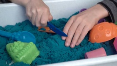 Boy's hands playing with the molding sand Stock Footage