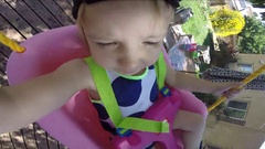 Toddler Girl Snory Cam on Swing Stock Footage