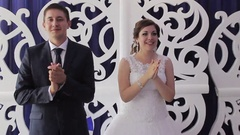 Bride and groom on their wedding clap Stock Footage