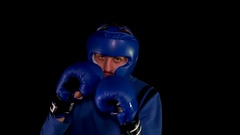 Boxer on a black background Stock Footage