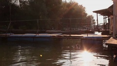 Small resting houses - wood raft cottages at river Sava in Belgrade, Serbia at s Stock Footage