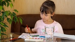 The child draws paints Stock Footage