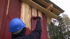 Worker  painting house with red paint Arkistovideo