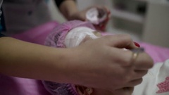 Beautician Applying Facial Mask On A Beautiful Child Girl Face At Beauty Salon Stock Footage