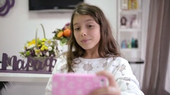 School Girl Brunette makes Selfie with Sell Phone Mobile - home livingroom day Stock Footage