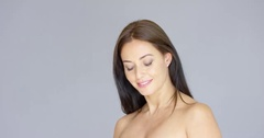 Cute single bare shouldered young adult woman Stock Footage