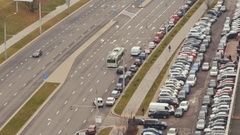 Road with car traffic. Car parking Stock Footage