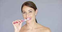Attractive smiling woman brushing her teeth Stock Footage