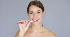 Healthy young woman cleaning her teeth Stock Footage