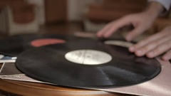 Male hands carefully puts vintage vinyl record on the table. Close up. Stock Footage