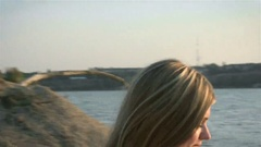 Young white-haired girl in bikini smiling at camera Stock Footage