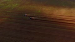 Bird view two tractor on ploughed field 5 Stock Footage